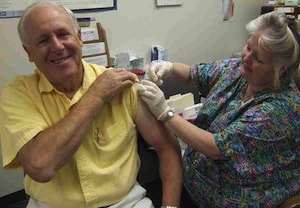 Cole Memorial's Board Member Dave Crandall received an influenza vaccine from Val Tinder, RN at Cole Memorial for flu prevention and protection for patients and others.