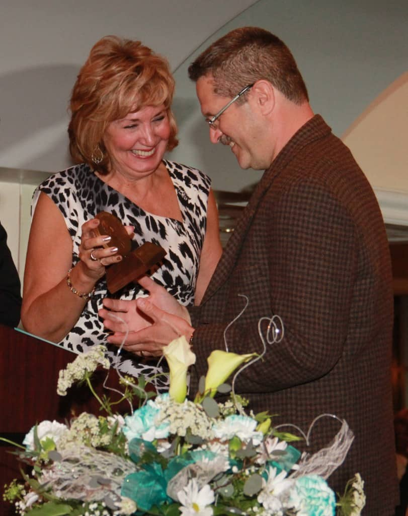 Monongahela Valley Hospital's 2013 Protin Award Winner Dale Varega, of Monongahela, accepts his award at the hospital's 41st Annual Service Awards Dinner on May 6 at the Willow Room in Rostraver, from last year's winner, Mary Lou Murt, senior vice president of Nursing.