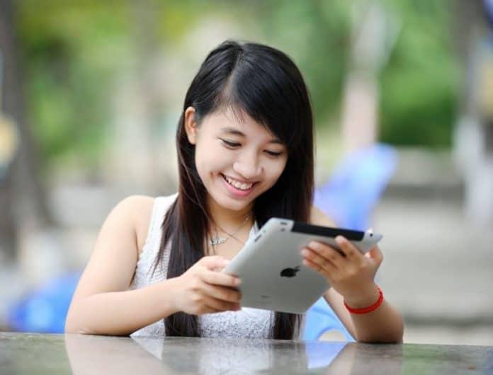 Kid looking at an ipad